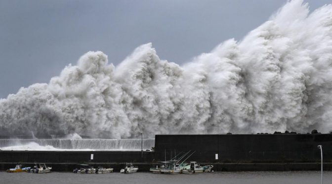 2 Dead As Typhoon Hits West Japan, Flooding Airport