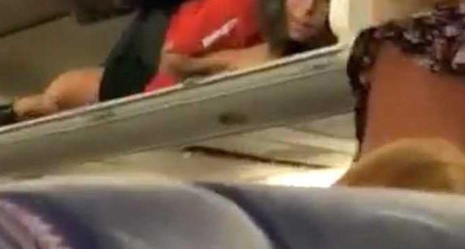 Southwest Airlines Flight Attendant Crawls Into Plane's Overhead Bin as Passengers Board Aircraft