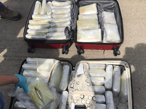 Customs agent took nearly 18 kilos of cocaine to Atlanta airport, feds say