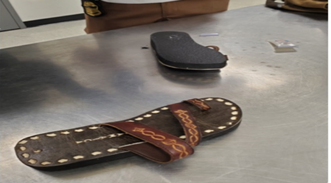 His sandals looked a little too heavy to customs agents at MIA. Their hunch was right.